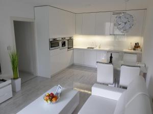 Kuchyňa alebo kuchynka v ubytovaní Apartmány Urban