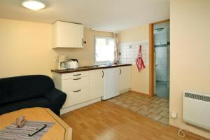 A kitchen or kitchenette at Holiday village am Weinberg Dobbrikow - DBS05003-BYB