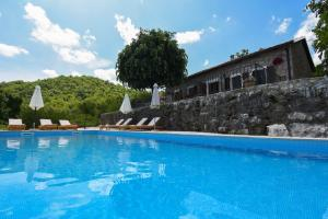The swimming pool at or near ETNO RESORT GRANDFATHER'S SECRET