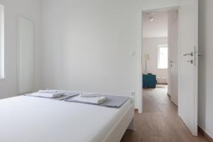 A bed or beds in a room at Apartments Coast 27