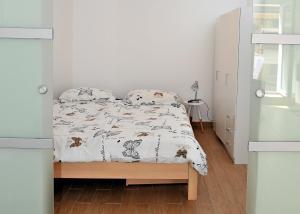 Postelja oz. postelje v sobi nastanitve Apartma prana