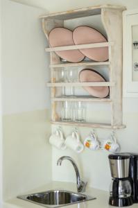Η κουζίνα ή μικρή κουζίνα στο Africanis Suites