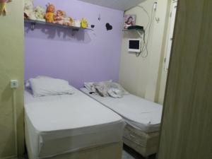 A bed or beds in a room at Casa dos Srs. Flávio e Maria José