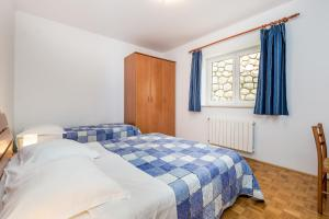 A bed or beds in a room at Apartments Gea