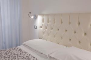 Una cama o camas en una habitación de Appartamenti Museo