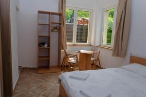 A bed or beds in a room at Casa Pasteur