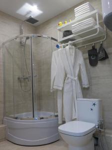 A bathroom at Family Apartments