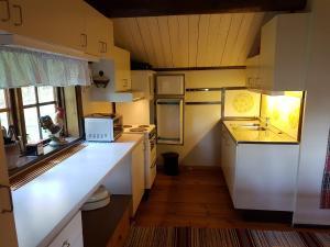 Küche/Küchenzeile in der Unterkunft Stuga Lycka