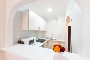 Een keuken of kitchenette bij Apartamentos Casa Vida