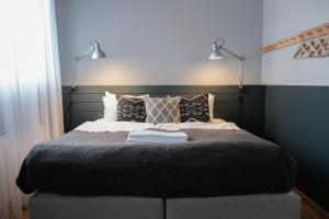 A bed or beds in a room at The Swan House by ylma