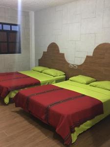 A bed or beds in a room at Hotel y Centro de Convenciones Castillo del Rey