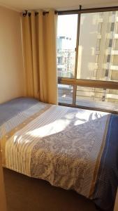 Cama o camas de una habitación en Bellapart Santiago