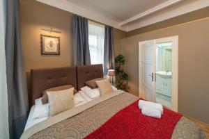 Ένα ή περισσότερα κρεβάτια σε δωμάτιο στο Old Town - Aparthotel Michalska
