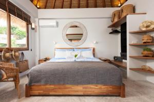 A bed or beds in a room at Cape Shark Villas