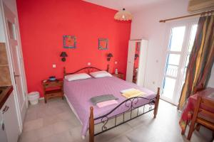Ένα ή περισσότερα κρεβάτια σε δωμάτιο στο Studios Zafiri