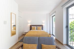A bed or beds in a room at Orange 3 House - Chiado Studios