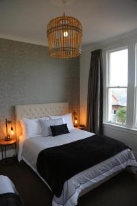 A bed or beds in a room at Majestic Mansions – Apartments at St Clair