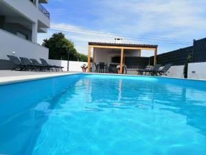 Bazén v ubytování Villa Apartment AA 2 nebo v jeho okolí