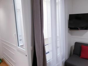 A television and/or entertainment centre at Apartment Quartier Latin - Monge