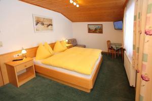 Ein Bett oder Betten in einem Zimmer der Unterkunft Ferienwohnung/Apartment Erna Prommegger