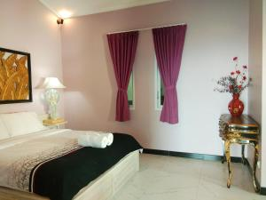 A bed or beds in a room at The Kayu Manis Villa & Spa