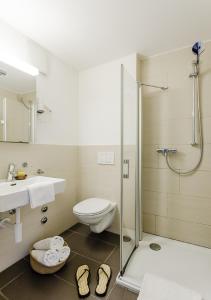 Ein Badezimmer in der Unterkunft Swiss Star Guesthouse District 3 - contactless self check-in