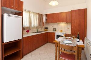 A kitchen or kitchenette at Faos Luxury Apartments