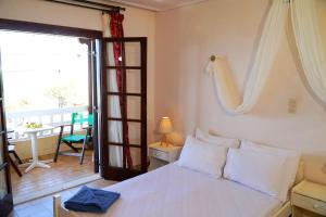 Lova arba lovos apgyvendinimo įstaigoje Vasilaras Hotel