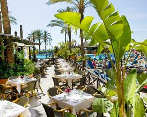 A restaurant or other place to eat at SUNSET BEACH CLUB