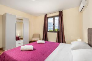 Krevet ili kreveti u jedinici u objektu Deluxe apartments Trsat