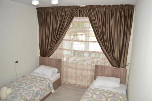 A bed or beds in a room at IZAURA LUX 2