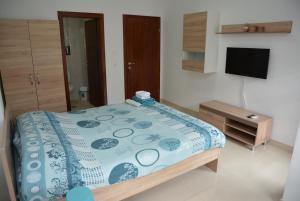 Postelja oz. postelje v sobi nastanitve Apartment Villa Dudanov