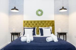 Posteľ alebo postele v izbe v ubytovaní Beautiful Cracow Apartments
