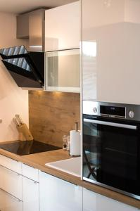 A kitchen or kitchenette at Arka plan