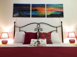 En eller flere senger på et rom på Appartamenti Monacò