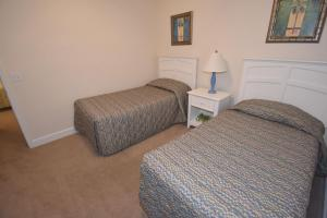 Cama o camas de una habitación en Lucaya Village by FVH