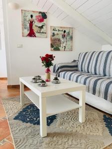A seating area at La Maison De Sophie