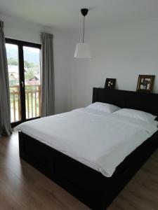 Postelja oz. postelje v sobi nastanitve CARNIOLAN HOUSE - GORENSKA HIŠKA