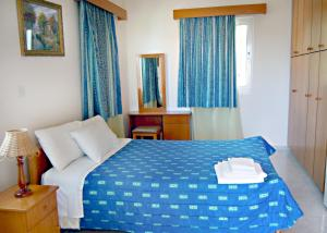 A bed or beds in a room at Rododafni Villas
