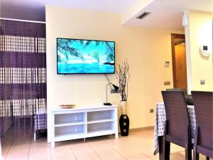 A television and/or entertainment center at Lloret Beach Apartments