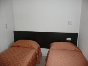 A bed or beds in a room at Aparthotel Alessandria