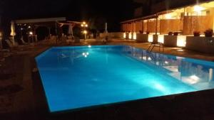 The swimming pool at or close to Oceanis Rooms Apartments