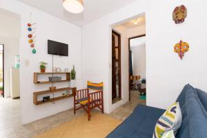 A television and/or entertainment center at Colorful flat in the heart of Antigua