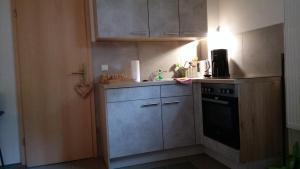 Küche/Küchenzeile in der Unterkunft Küstenpferde Boltenhagen