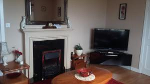 A television and/or entertainment center at Grianan Cottage