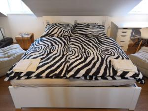 Posteľ alebo postele v izbe v ubytovaní Prague Castle View Apartment with Air conditioning