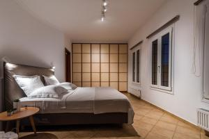 A bed or beds in a room at Villa Marisol