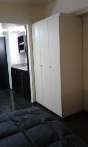 Una cama o camas en una habitación de Apartamento Exclusivo Center