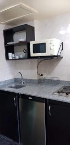 Una cocina o kitchenette en Apartamento Exclusivo Center