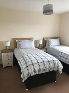 A bed or beds in a room at Self Catering Accommodation, Isle of Benbecula